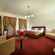 Double room with extra bed and entrance into courtyard balcony