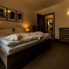 Apartmán - posteľ