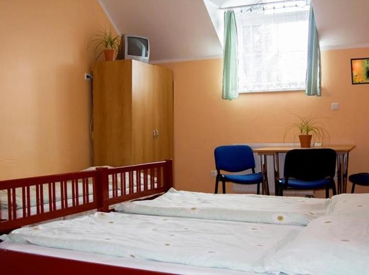 Vícelůžkový pokoj bez SWC budova Saxana