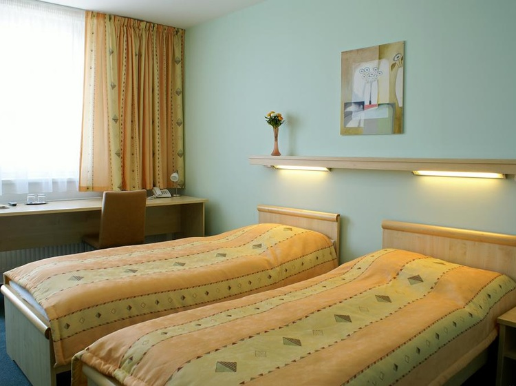 Třílůžkový pokoj - ložnice