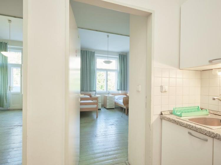 AP4 - apartmán Klasik Dva dvoulůžkové pokoje se společnou kuchyňkou a příslušenstvím)