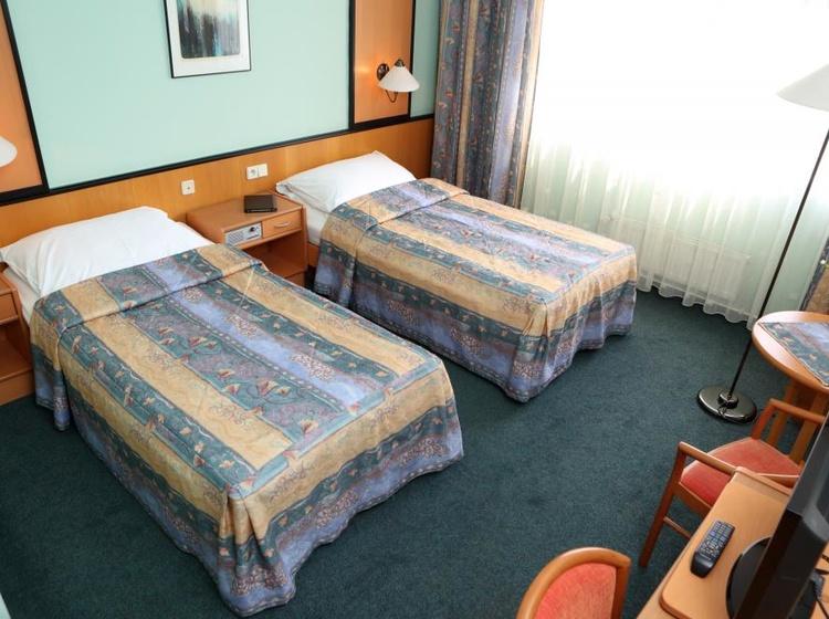 Pokoj Superio s oddělenámi postelemi