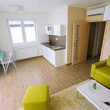 obývací prostor s kuchyňkou