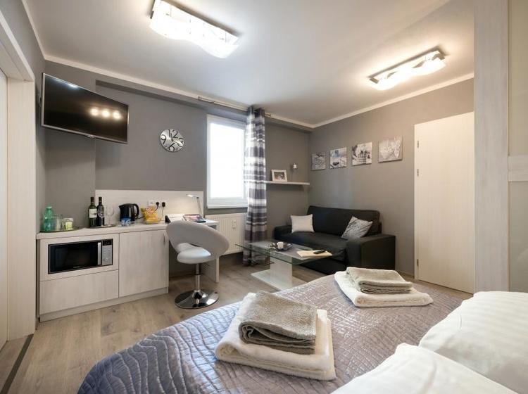 Obývací pokoj s manželskou postelí Apartmá A5