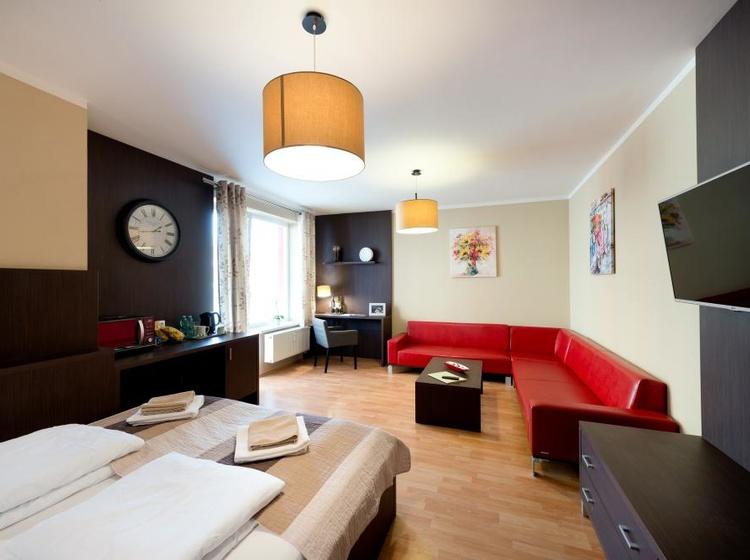 Obývací pokoj s ložnicí Apartmá A7